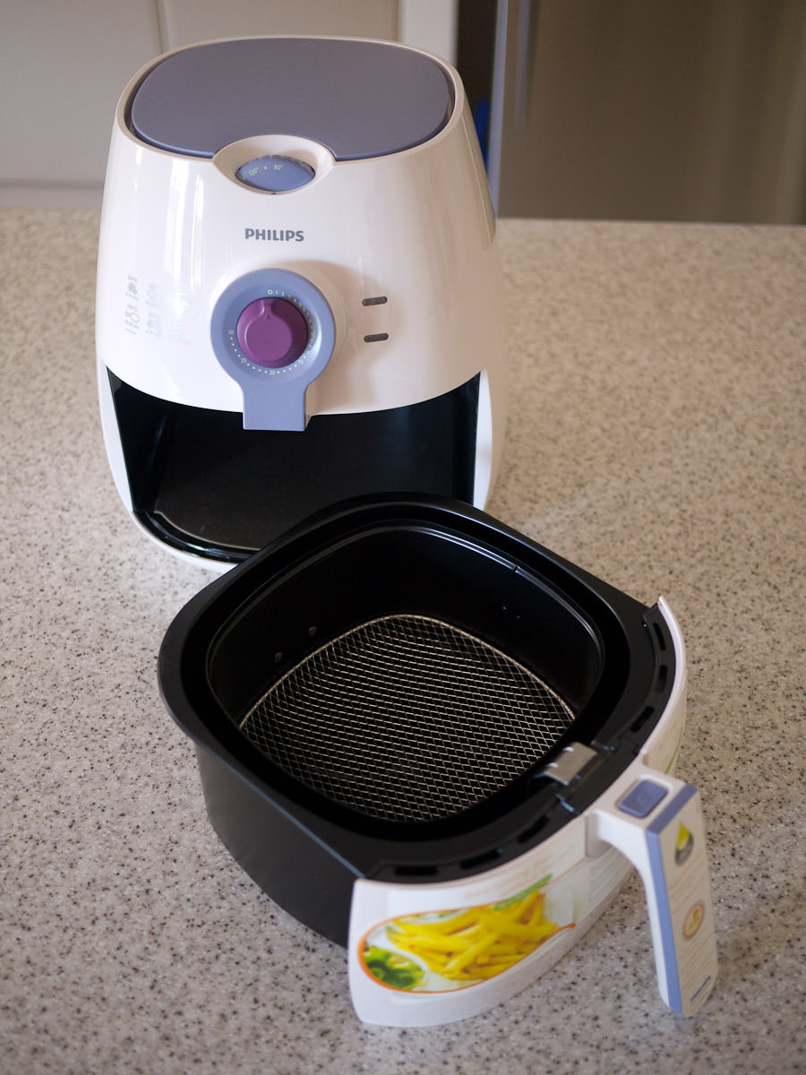 Where do you put the oil in a Philips Air fryer